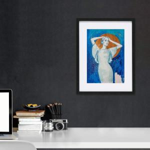 Framed art print above desk